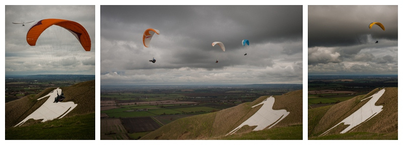 Amazing wind gliders and parachutists at the White Horse in Westbury, Wiltshire by wedding photographer Barbara Leatham
